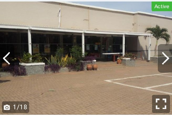 COMMERCIAL PROPERTY ON ALMOST 1 ACRE LAND, MAIN ROAD LEGON