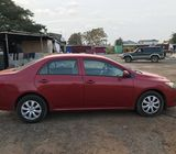 Red Toyota Corolla LE