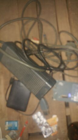 Xbox 360 power adopter with one controller