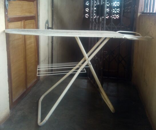 Ironing board with adjustable knob