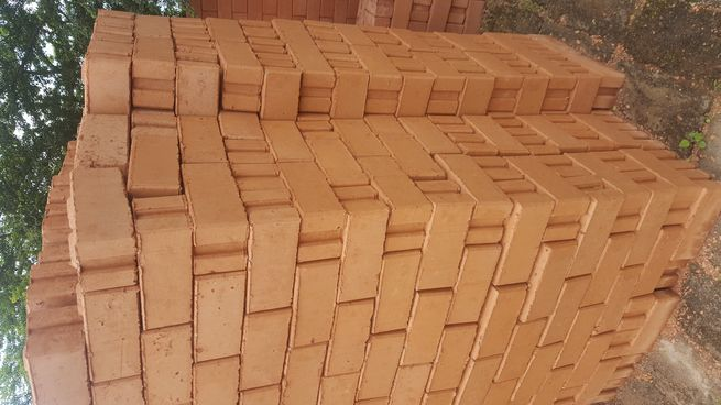 Hydro formed interlocking bricks